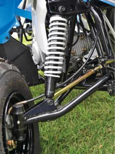 2014.polaris.outlaw90.close-up.front-suspension.JPG