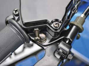 2014.polaris.outlaw90.close-up.throttle-limitor-screw.JPG