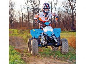 2014.polaris.outlaw90.front_.blue_.jumping.in-air.jpg