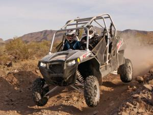 2014.polaris.rzr4-900eps.front-left.silver.jumping.in-air.jpg