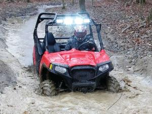 2014.polaris.rzr_.red_.front_.riding.through-mud.JPG