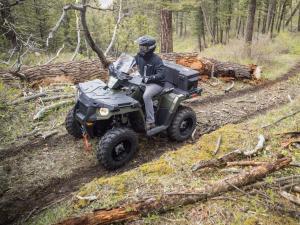 2014.polaris.sportsman570.green.left.riding.through-woods.jpg