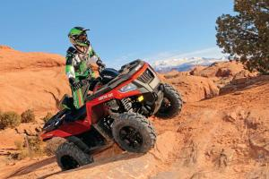 2015.arctic-cat.xr700eps.red_.front-right.riding.over-rocks.jpg