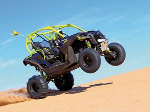 2015.can-am.maverick-x-ds1000r-turbo.black.right.riding-wheelie.on-sand.JPG