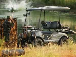 2015.club-car.xrt850.camo.front-left.hunting.by-lake.jpg