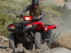 2015.honda_.four-trax-foreman4x4.red_.front-right.riding.over-rocks.jpg