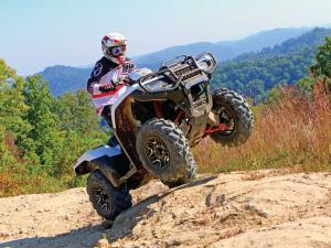 2015.honda_.fourtrax-foreman-rubicon.white_.front-right.riding.wheelie.jpg