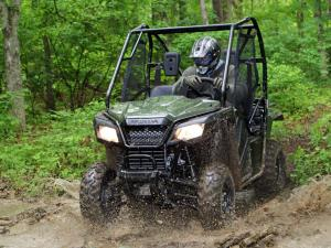 2015.honda.pioneer500.green.front.riding.through-mud.JPG