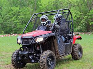 2015.honda.pioneer500.red.front-left.riding.on-grass.JPG
