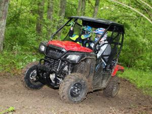 2015.honda.pioneer500.red.front-left.riding.on-trail.JPG