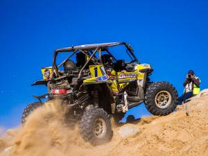 2015.polaris.racer.chad-hughes.racing.rzr.riding-up-hill.at-king-of-the-hammer.jpg