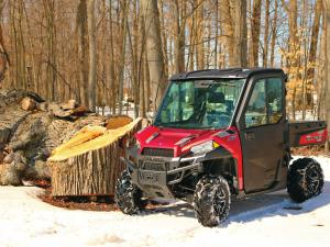 2015.polaris.ranger-xp900northstar.red.front-left.parked.on-snow.jpg