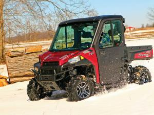 2015.polaris.ranger-xp900northstar.red.front-left.riding.on-snow.jpg