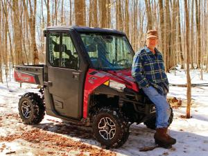 2015.polaris.ranger-xp900northstar.red.front-right.parked.on-snow.jpg