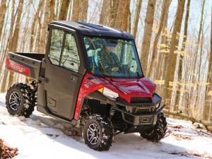 2015.polaris.ranger-xp900northstar.red.front-right.riding.on-snow.jpg