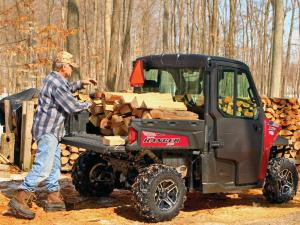 2015.polaris.ranger-xp900northstar.red.rear-right.parked.loading-wood.jpg