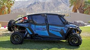 2015.polaris.rzr-xp4-1000custom.right_.blue_.parked.on-grass.jpg