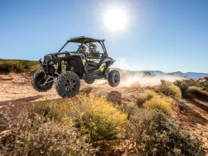 2015.polaris.rzr1000.blue_.front-left.jumping.in-air.jpg