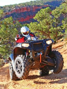 2015.polaris.sportsman-xp1000.silver.front.riding.on-dirt.jpg
