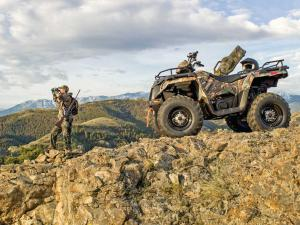 2015.polaris.sportsman.camo.parked.by-hunters.jpg