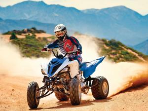 2015.yamaha.raptor700.blue-and-white.front-left.riding.on-sand.JPG