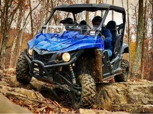 2015.yamaha.wolverine.blue_.front-left.riding.over-rocks.jpg
