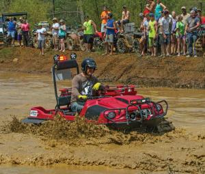 2016.argo.avenger8x8lx.red.front-right.riding.through-mud.jpg