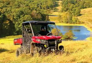 2016.can-am.defender.red.front-right.riding.on-grass.jpg