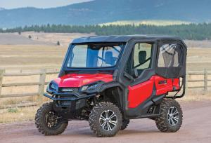2016.honda.pioneer1000-5.red.front-left.parked.on-dirt-road.jpg