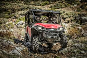 2016.honda.pioneer1000-5deluxe.red.front.riding.over-rocks.jpg