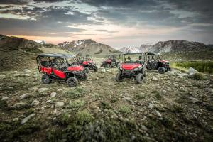 2016.honda_.pioneer1000.red_.family-group-shot.parked.on-rocks.jpg