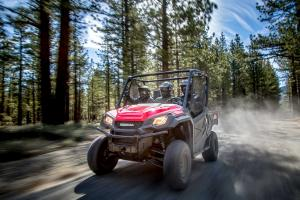 2016.honda_.pioneer1000.red_.front-left.riding.on-trail.jpg
