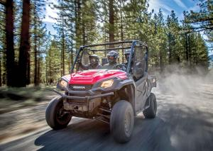 2016.honda.pioneer1000.red.front-left.riding.on-trail.jpg