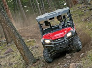 2016.honda.pioneer1000.red.front.riding.on-path.jpg