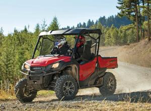 2016.honda.pioneer1000.red.left.riding.on-trail.jpg