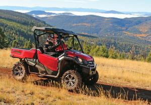 2016.honda.pioneer1000.red.right.riding.in-field.jpg