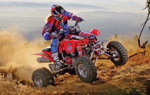 2016.honda.trx450r.red.front-right.riding.on-dirt.jpg