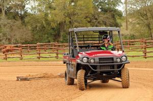 2016.kawasaki.mule-pro-dx-diesel.red.front.dragging-grader.in-field.jpg