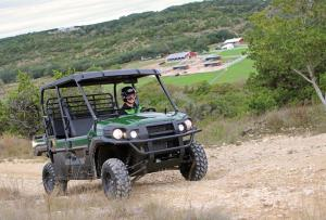 2016.kawasaki.mule-pro-dxt-diesel.green.front-right.riding.on-dirt-road.jpg