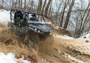 2016.kawasaki.teryx4_.black_.front-right.riding.through-mud.jpg