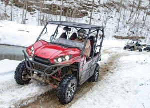 2016.kawasaki.teryx.red.front-left.riding.on-snow.jpg