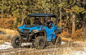 2016.polaris.general1000eps.blue.front-left.riding.on-path.jpg
