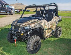 2016.polaris.general1000eps.camo_.front-left.parked.on-grass.jpg