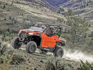 2016.polaris.general1000eps.orange.front-left.riding.on-path.jpg