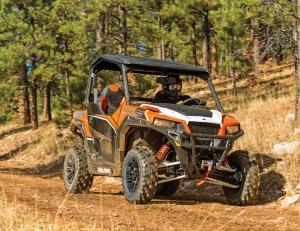 2016.polaris.general1000eps.orange.front-right.riding.on-path.jpg