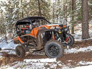 2016.polaris.general1000eps.orange.right.riding.on-path.jpg