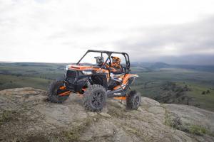2016.polaris.rzr-xp-turbo-eps.orange.front-left.parked.on-rocks.jpg