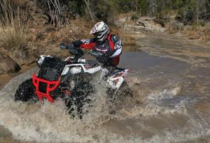 2016.polaris.scrambler-xp1000.white.front-left.riding.through-water.jpg