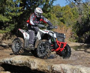 2016.polaris.scrambler-xp1000.white.right.riding.on-rocks.jpg
