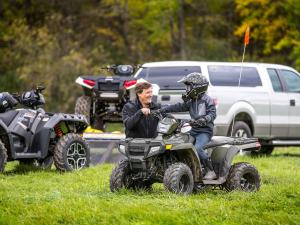 2016.polaris.sportsman110.green.front-left.riding.on-grass.jpg